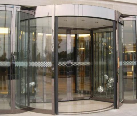two wings revolving glass door