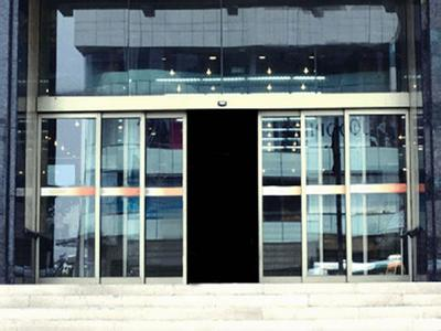 Automatic telescopic sliding door